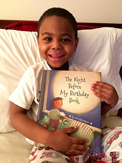 Boy with The Night Before My Birthday Book